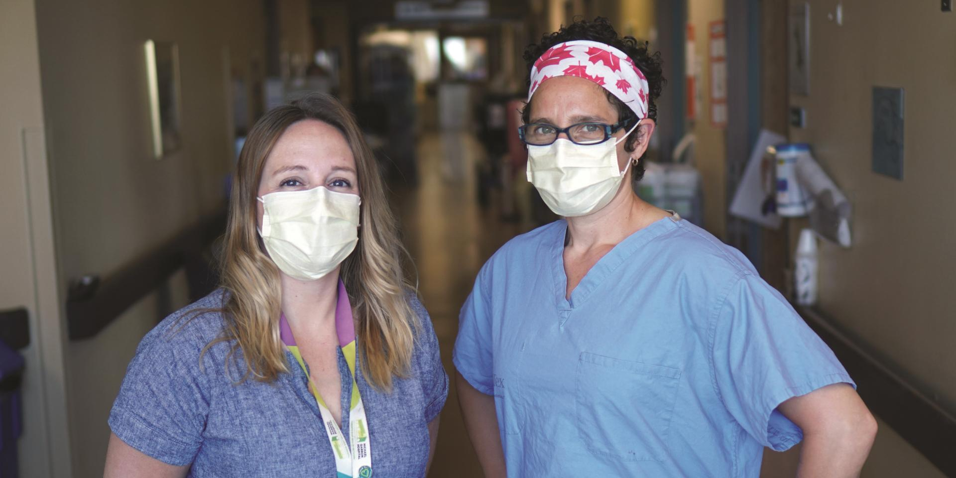two medical clinicians wearing masks
