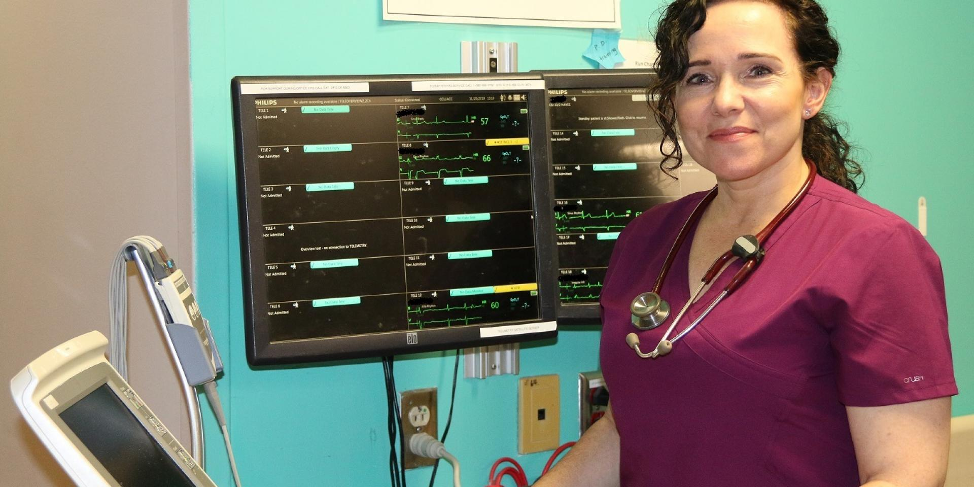 nurse standing in front of monitoring equipment