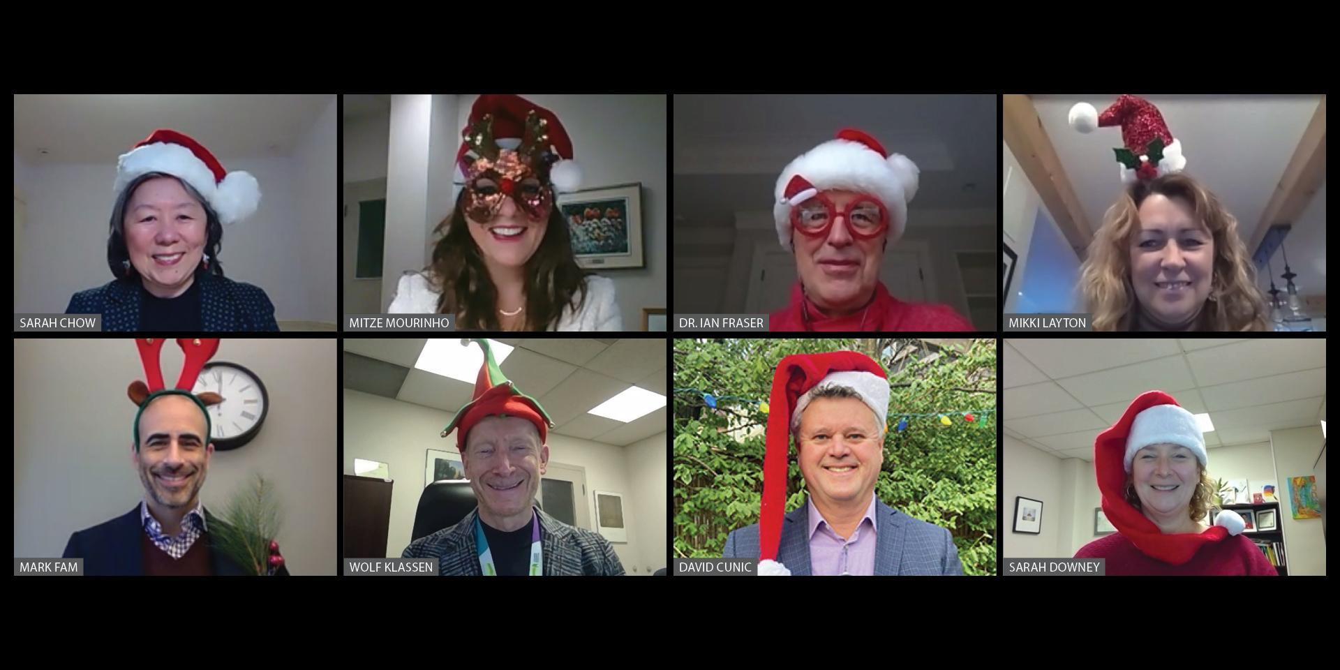 executive team all wearing holiday hats