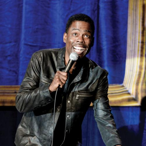 Chris Rock talking into microphone