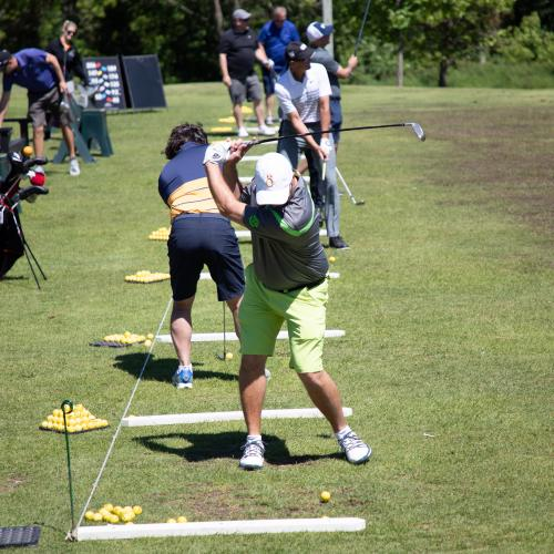 view of golfers at driving range