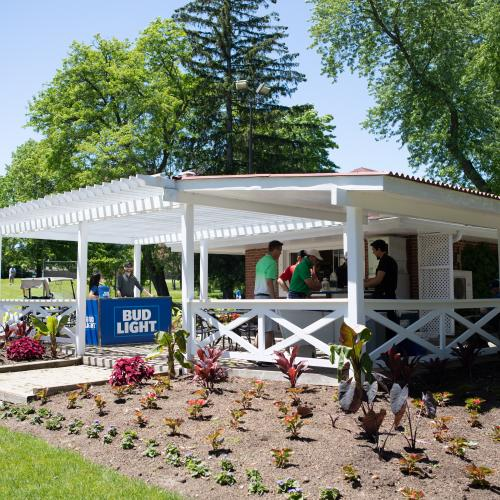 view of Bud Light sponsored beverage hut with several golfers