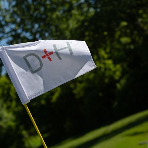 close up view of D+H sponsor flag