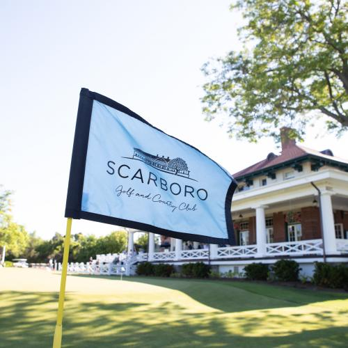 close up view of Scarboro Golf and Country Club flag with clubhouse in background