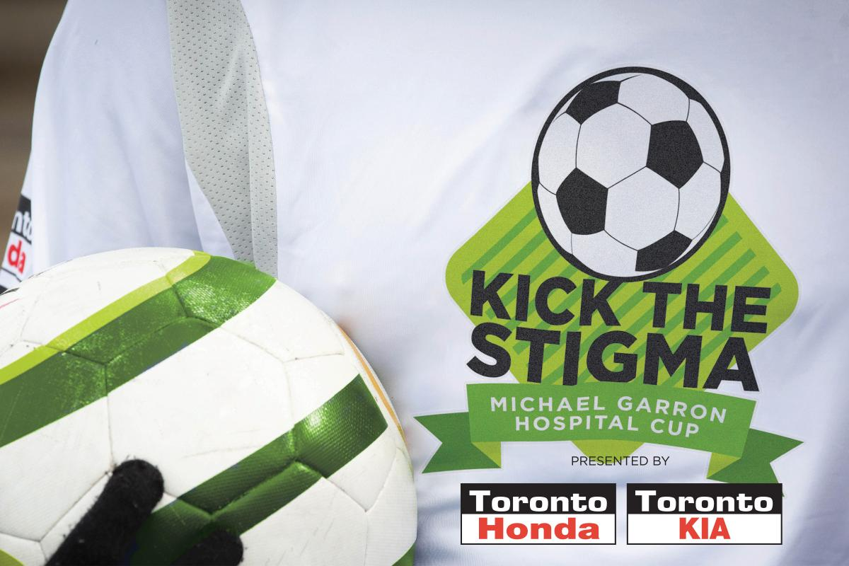 Kick the Stigma logo on t-shirt with soccer ball
