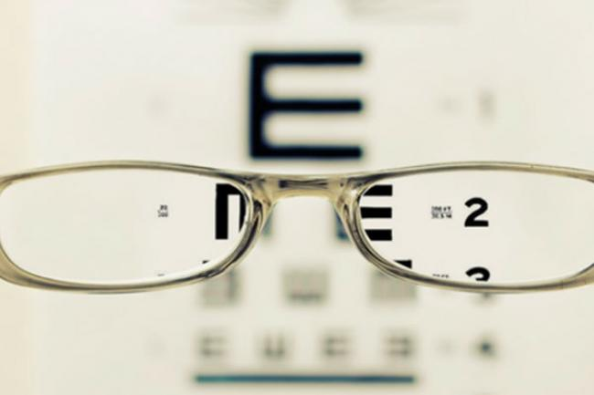 eyeglasses in front of eye chart