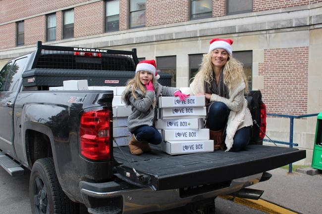 East Toronto resident Richelle Johnston and daughter Sydney, age six, unload Love Boxes at Michael Garron Hospital.