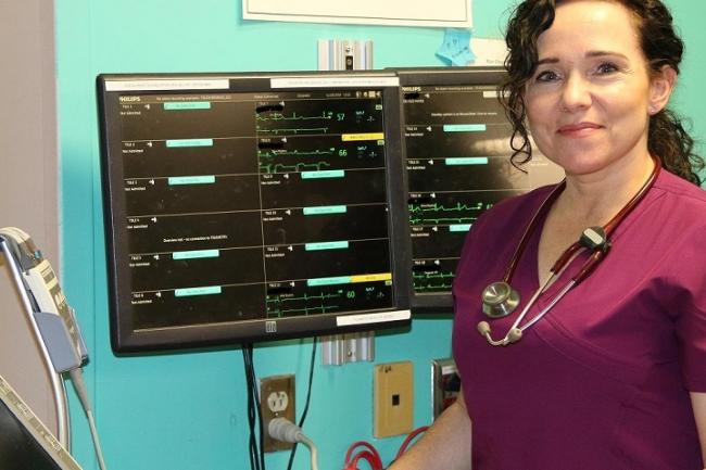 Nurse standing in front of monitor