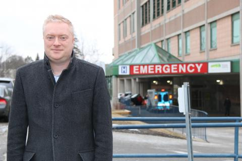 man standing outside in front of emergency department